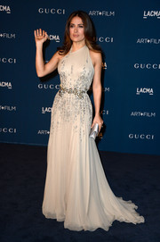 Salma Hayek looked downright divine in an embellished nude halter gown by Gucci Premiere during the LACMA Art + Film Gala.