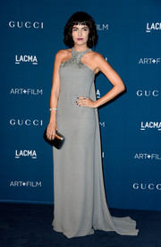 Camilla Belle chose a gray Gucci evening dress featuring an embellished racer neckline for the LACMA Art + Film Gala.