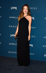 Olivia Wilde was all about understated elegance in a black Gucci halter dress when she attended the LACMA Art + Film Gala.