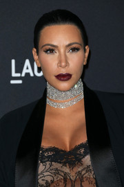 Kim Kardashian attended the LACMA Art + Film Gala sporting vampy wine-colored lipstick.
