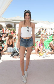 Kendall Jenner completed her sexy outfit with a pair of jean shorts.