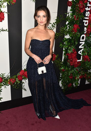 Danielle Campbell styled her gown with a small white purse.