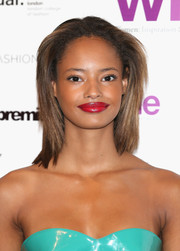 Malaika Firth sported a red-hot pout that contrasted strikingly with her aqua-blue dress.