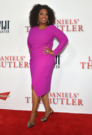 Oprah showed off her glamorous side with this bright grape long-sleeve dress.