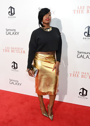 Fantasia's long-sleeve black crop top added a little bit of a casual touch to her glam gold skirt.