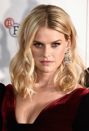 Alice Eve paired her gorgeous 'do with dangling floral diamond earrings.