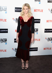 Alice Eve was svelte and elegant in a red and black velvet-panel dress by Roland Mouret at the BFI London Film Festival screening of 'Black Mirror.'
