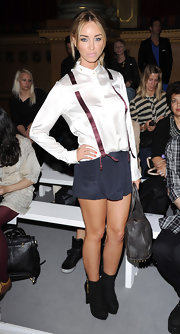 Lauren looked classy at London Fashion Week in a white silk blouse with braces.