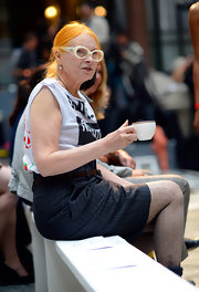 Vivienne Westwood paired a black pinstripe skirt with a distressed shirt during her Spring 2013 fashion show.