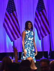 Michelle Obama takes the stage in a blue floral shift.
