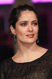 Salma Hayek wore her hair in a casual loose bun at the premiere of 'La Chispa de la Vida in Berlin, Germany.