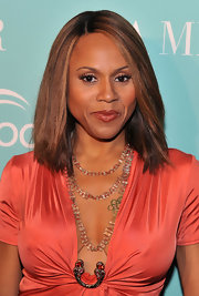 Singer Deborah Cox styled her locks in a sleek straight cut at the celebration of World Oceans Day. Subtle highlights helped highlight her look.