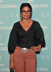 Rachel wears a black button down with pouf sleeves for the Oceana event.