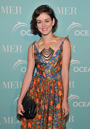 Nora Zehetner paired her printed summer dress with a layered beaded statement necklace.