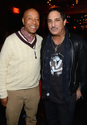 Russell Simmons looked classic and preppy in a v-neck sweater worn over a plaid button-down.