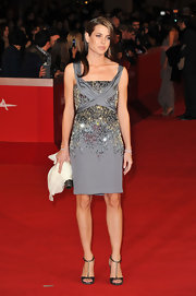Charlotte radiated like a true style star on the red carpet. The royal fashion maven opted for a gray cocktail dress complete with a beaded bodice.