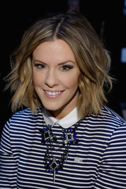 Courtney Kerr wore an edgy-cute short wavy 'do during the Lacoste fashion show.