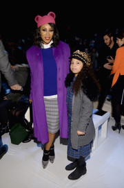 June Ambrose layered a purple fur coat over a cobalt sweater for a striking color-blocked look during the Lacoste fashion show.