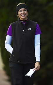 Allison Micheletti braved the cold in a black North Face fleece vest during the Ladies European Tour.