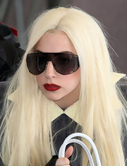 Lady Gaga amped up her simple look with ravishing red lipstick.
