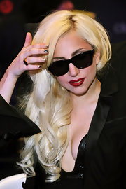 While signing copies of her new CD 'Monster,' Lady Gaga donned blood red lipstick.