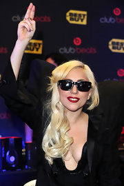 Lady Gaga rocked a cool pair of rectangle shades while signing her 'Monster' CD.