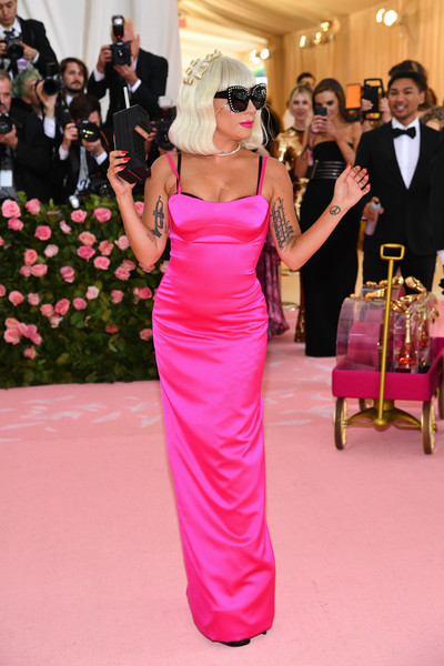 Lady Gaga Form-Fitting Dress [dress,red carpet,pink,carpet,gown,shoulder,flooring,clothing,facial expression,formal wear,fashion - arrivals,lady gaga,notes,fashion,new york city,metropolitan museum of art,met gala celebrating camp]