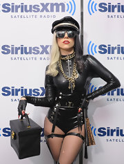 Lady Gaga dramatized her eccentric look with a black leather cap. Gold chains, claw nails and fishnet tights were amongst the many accessories of the look.