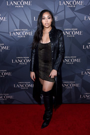 Black over-the-knee boots rounded out Jordyn Woods' edgy attire.