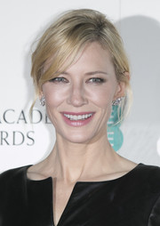 Cate Blanchett attended the Lancome BAFTA nominees party wearing her hair in a messy bun.
