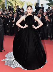 Araya A. Hargate made another head-turning entrance at Cannes in a voluminous black Jean Paul Gaultier Couture ball gown with a striped underskirt during the premiere of 'From the Land of the Moon.'
