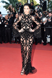 Kendall Jenner put plenty of skin on display in a sheer, snake-embellished gown by Roberto Cavalli Couture at the Cannes premiere of 'From the Land of the Moon.'