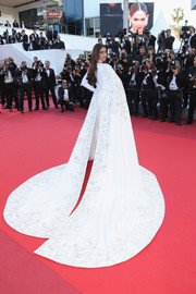 Sonam Kapoor easily stole the spotlight in an embroidered white Ralph & Russo Couture gown with a flowing cape during the Cannes premiere of 'From the Land of the Moon.'