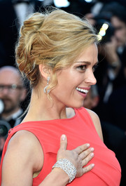 Petra Nemcova styled her hair into a loose, bobby-pinned updo for the Cannes premiere of 'From the Land of the Moon.'