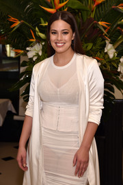 Ashley Graham spiced up her LWD with a Fleur Du Mal corset when she attended her book launch.