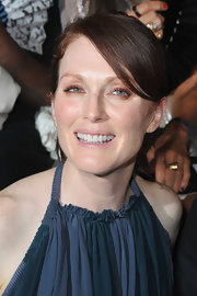 Julianne Moore wore just a touch of makeup to the Lanvin spring/summer 2012 fashion show in Paris. She looked fresh and flawless with a little mascara, powder and a touch of lipgloss.