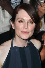 To recreate Julianne Moore's eye makeup look, begin by lining the top and bottom lash lines with a medium brown eye pencil. Next, sweep a copper-y shade of shadow like Stila Eye Shadow in Copper or Jezebel over the upper lids and pat lightly over the eye pencil, gently smudging it with fingertips or a cotton swab. Finish off the look with a coat of mascara.