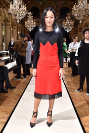Nicole Warne rocked a lingerie-inspired sweater dress at the Lanvin fashion show.