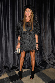 Anna dello Russo donned a black feather dress for the Lanvin fashion show--definitely not your basic LBD.