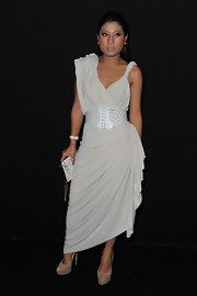 The Thai beauty accessorized her draped frock with suede platform pumps.