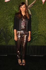 Rashida Jones toned down the shine a bit with a black cropped jacket by Lanvin.