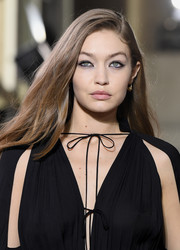 Gigi Hadid wore her long hair down with a side part at the Lanvin Menswear Fall 2020 show.