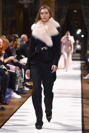 Arizona Muse looked lavish in a black peplum jacket with pink fur lapels while walking the Lanvin show.