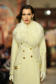 Bella Hadid was winter-glam in her white leather gloves and coat combo while walking the Lanvin runway.