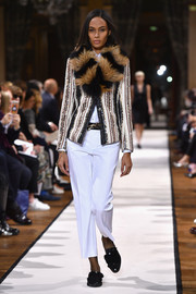 Joan Smalls was winter-chic in a fur-accented tweed jacket while walking the Lanvin runway.