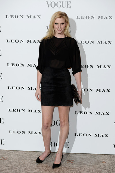 Lara Stone Mini Skirt [clothing,dress,cocktail dress,little black dress,shoulder,fashion,footwear,joint,shoe,long hair,red carpet,vogue,style,vogue 100,england,london,national portrait gallery,lara stone]