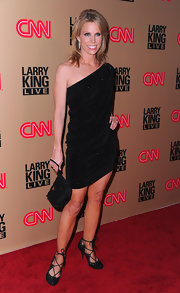 Cheryl Hines paired her black one shoulder dress with a simple black satin wristlet.