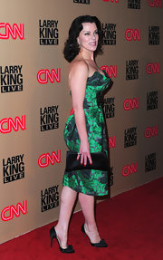 Debi Mazar donned black satin pumps with rosette embellishments. The heels were the perfect complement to her emerald green cocktail dress.