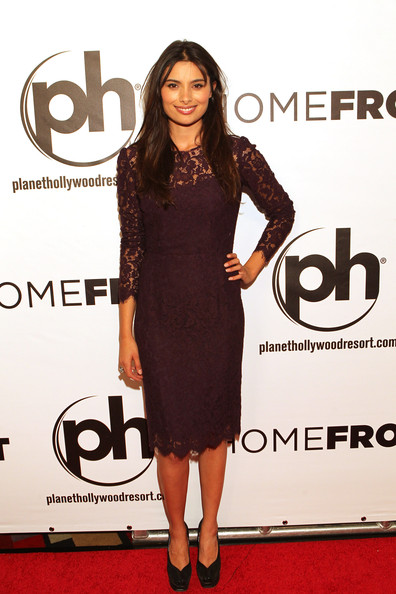 Gabriella Wright attended the premiere of 'Homefront' wearing a little burgundy lace dress.
