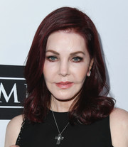 Priscilla Presley wore her hair down to her shoulders with curly ends at the Last Chance for Animals benefit.